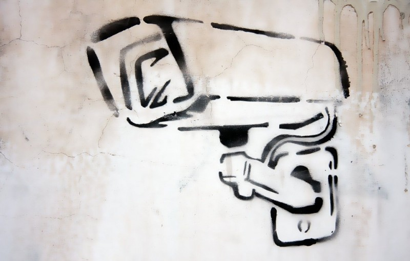 Graffiti art of surveillance camera. Published and labeled for reuse on Pixabay.