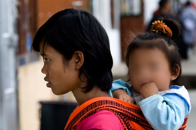 A mother and her child in Bhutan. Photo: Steve Evans / Flickr. CC 2.0. Edited by Kevin Rothrock.