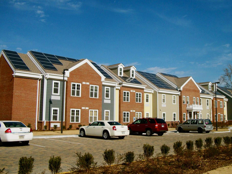 Virginia Supportive Housing's South Bay Apartments provide sixty supportive studio apartments for formerly homeless single adults in Portsmouth, Virginia. VSH installed the 28.29kW solar array to reduce their long term operating costs and display their commitment to responsible building practices. Photo by Flickr user Urban Grid. CC-BY-NC-SA 2.0