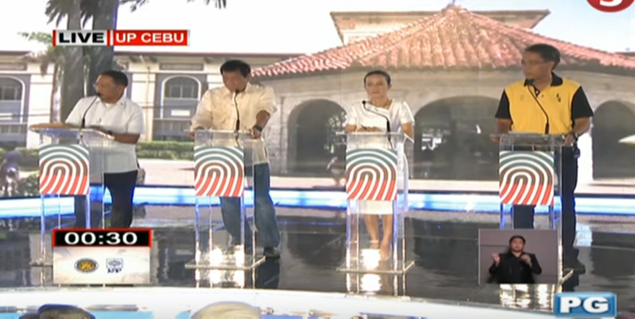 Philippine presidential candidates appearing in a televised debate. Vice President Jejomar Binay (extreme left) accused administration candidate Mar Roxas (extreme right) of behaving like 'Goebbels.'