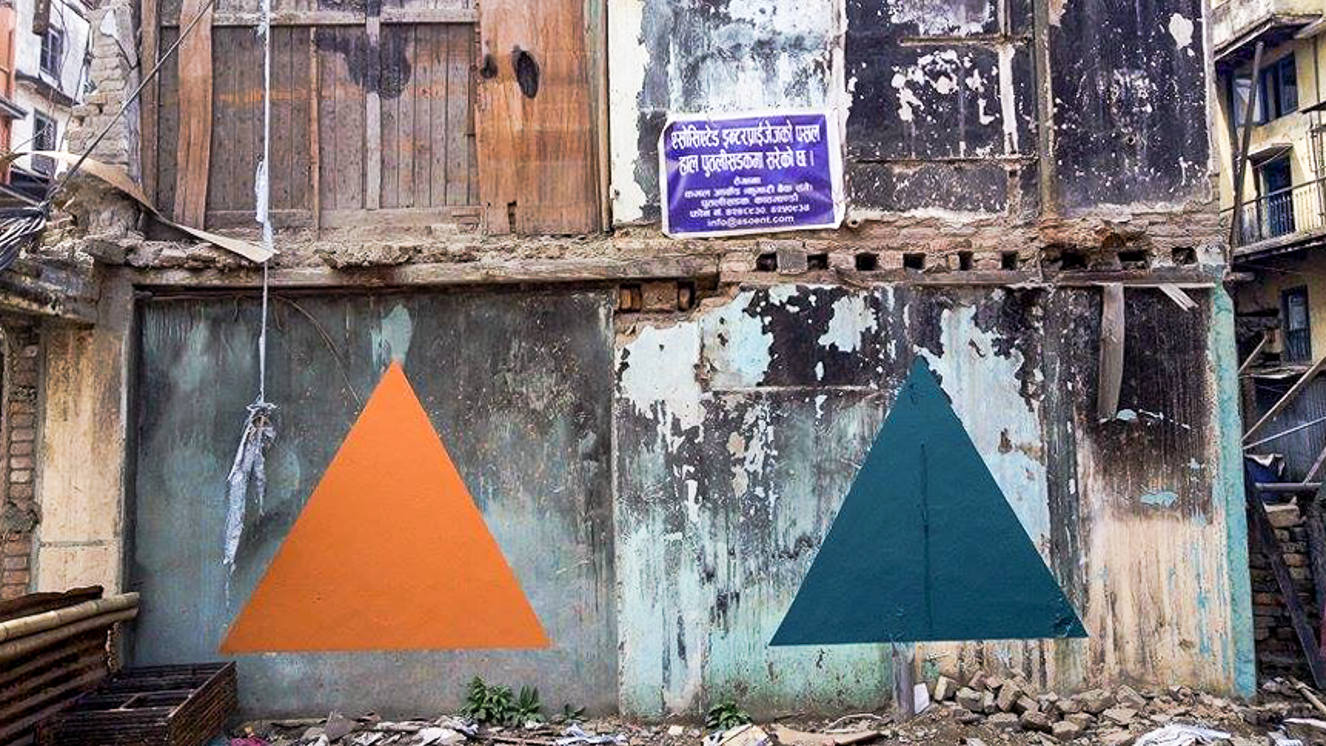 Triangolism in Kathmandu. Italian street artist Riccardo Ten Colombo painted equilateral triangles on buildings brought down by the earthquake. Image by Sunil Sharma. Used with permission.