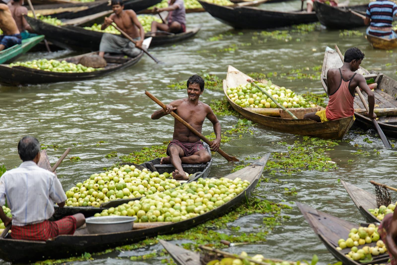 A Visual Journey Into the Floating Guava Markets of