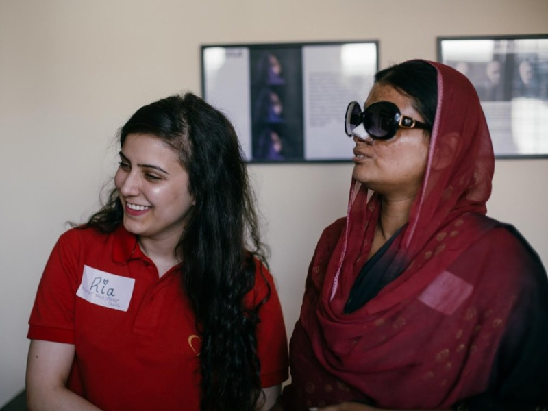 Sharma (L) and a survivor at the Make Love Not Scars Rehabilitation Center grand opening Credit: Avirat Sundra