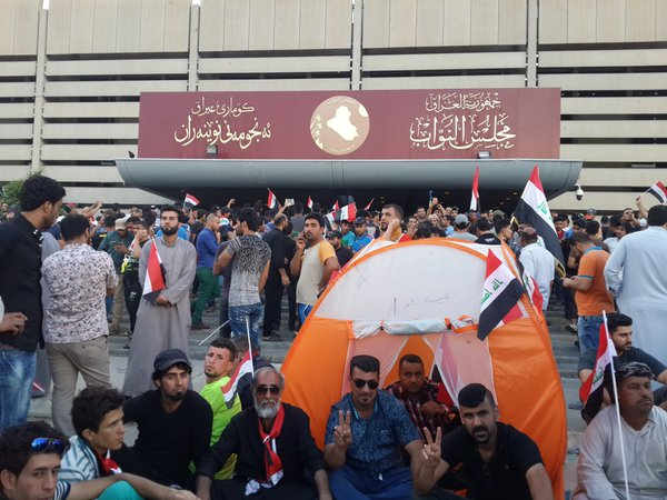 Iraqi protestors outside the Parliament earlier today where they staged a sit-in before storming the building. Photo credit: @AlFayth (Twitter)