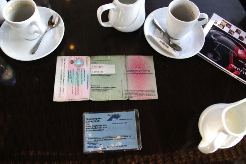 Dana Maghdeed Aziz's German identification cards on the table in a café in Erbil. After months in Germany he still didn't know if he would be granted asylum. Credit: Rebecca Collard