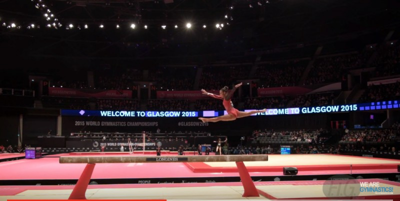 Screen shot of a YouTube video featuring Canadian-born T&T gymnast, Marisa Dick, competing at the FIG (International Gymnastics Federation) 2015 Artistic Worlds event, in the Qualifications for Balance Beam.
