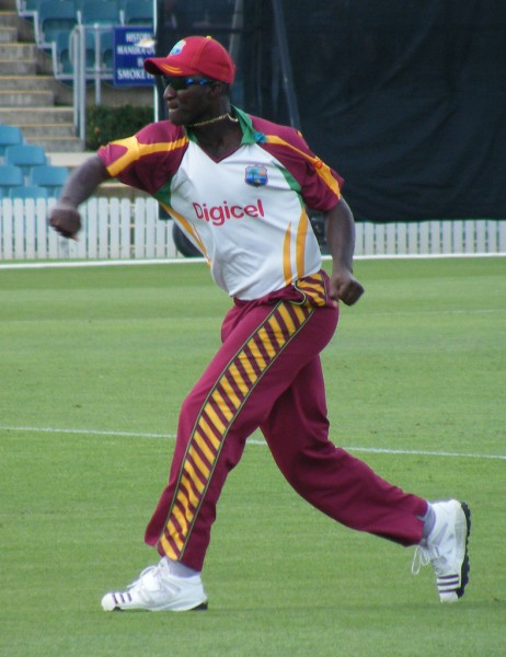 Darren Sammy, who captained the winning T20 team, playing at the Prime Ministers 11 Cricket match in Canberra 2010. Photo by NAPARAZZI, used under a CC BY-SA 2.0 license.