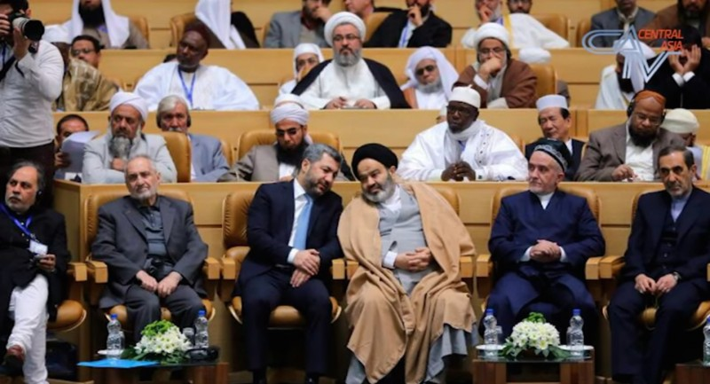 Tajik oppositionist Muhiddin Kabiri (in the suit on the left) hobknobs with Iranian officials at a religious unity conference in Tehran.