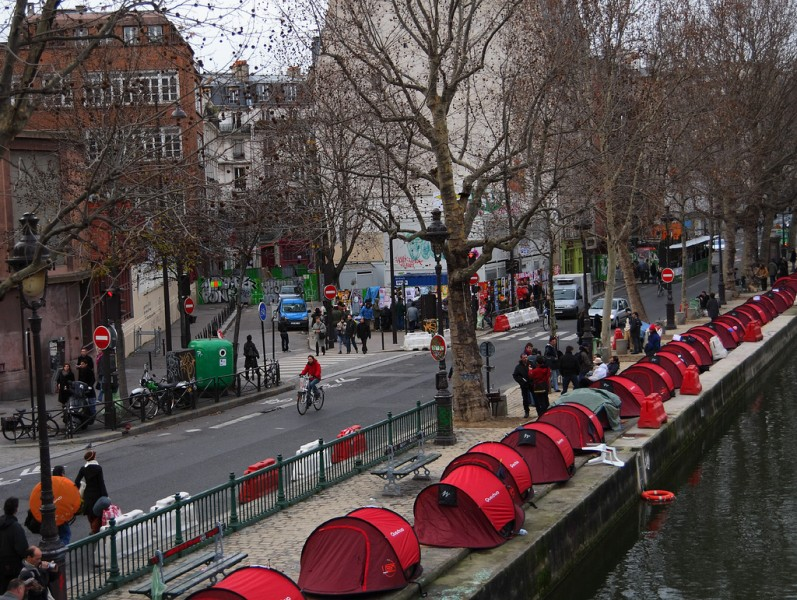 Tents from charity 'Les Enfants de Don Quichotte' on the banks of the Canal Saint-Martin, Paris. From Wikipedia Creative Commons 2.0