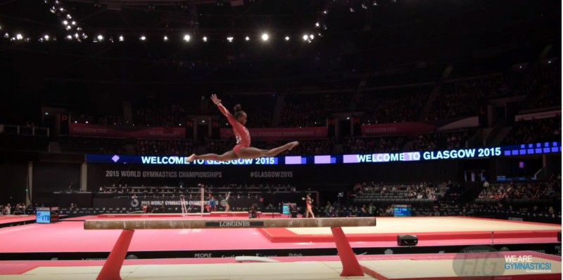 Screen shot of a YouTube video featuring Trinidad and Tobago gymnast, Thema Williams, competing at the FIG (International Gymnastics Federation) 2015 Artistic Worlds event, in the Qualifications for Balance Beam.