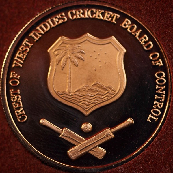 West Indies Cricket Medal, with the original crest of the West Indies Cricket Board of Control. The 'Control' was dropped from its official name in 1996, but many would argue that the organisation still hangs on to the sentiment in terms of its behaviour towards the players. Photo by Mark Morgan, used under a CC BY 2.0 license.
