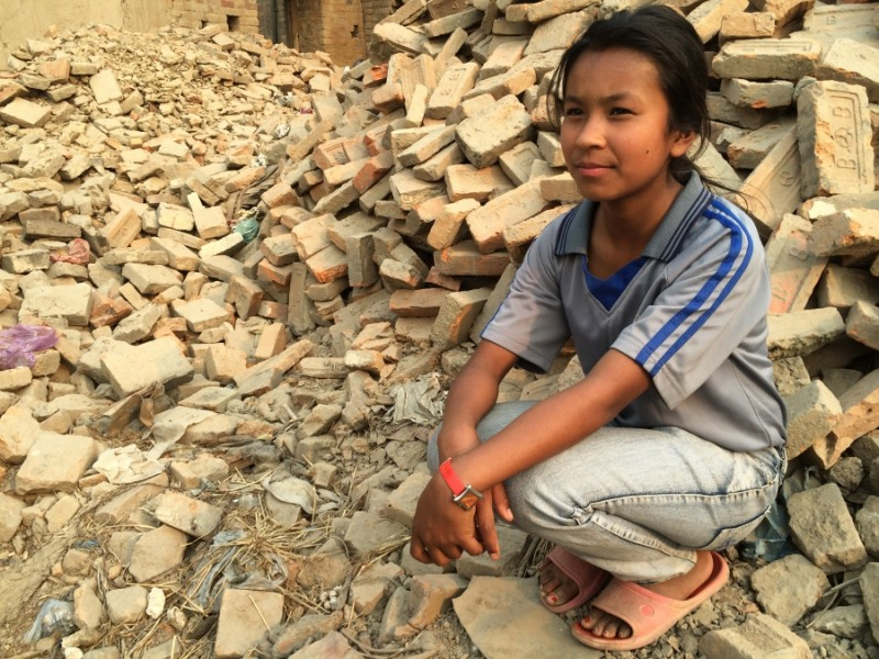 Shreesha Duwal at the site of her former home in Bhaktapur, Nepal Credit: Sonia Narang