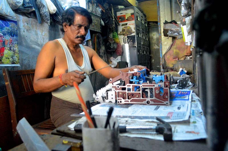 In a small shop on 35th Street, Mya Win, 62, repairs a broken typewriter purchased from a government auction. He has been working on the machines for 40 years. (Photo and caption: Sally Kantar / The Irrawaddy)