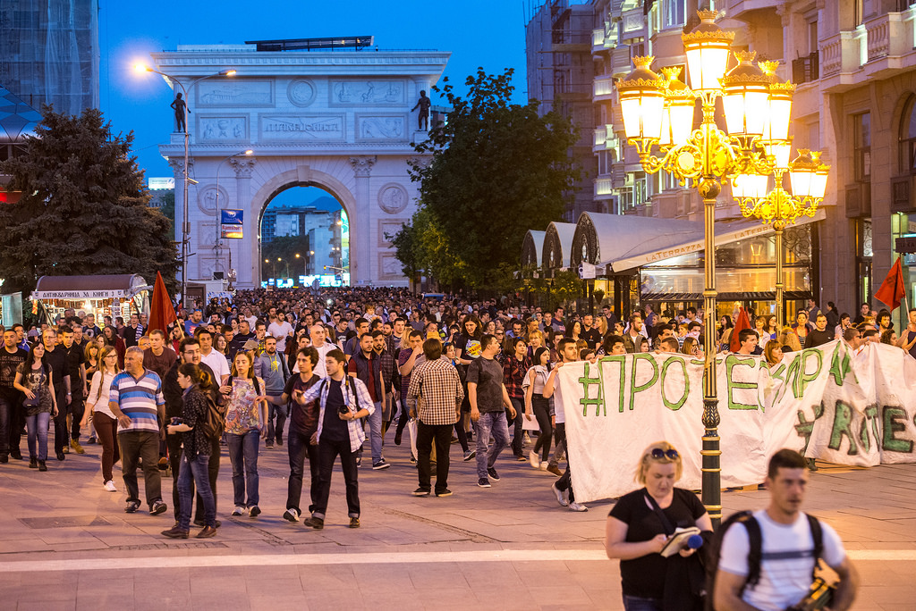 Protesters crossing under the Triumphal Arch, part of the infamous 'Skopje 2014' project for revamping the capital.