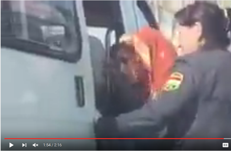 Footage from video police detaining women in hijab in Isfara city of Tajikistan in February 2016