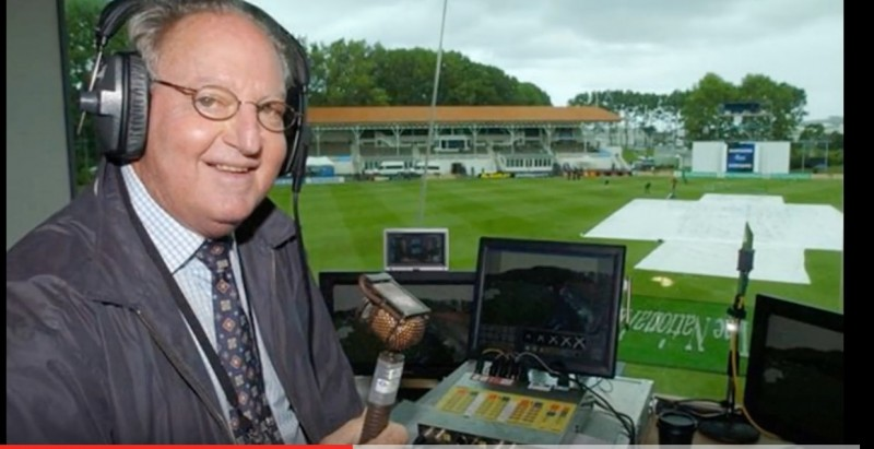 Screenshot of a YouTube tribute video to cricket legend Tony Cozier, which shows him in the commentary box during a match.