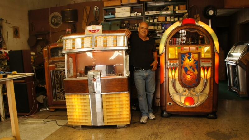 Magdi Hanna, from Alexandria, Egypt, runs one of the few workshops in the United States dedicated to saving jukeboxes. Credit: Saul Gonzalez. Used with permission.