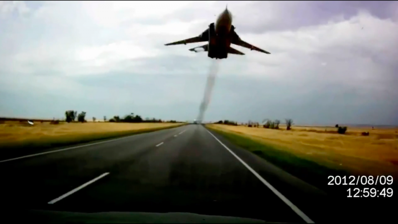 Russian Sukhoi Su-24 fighter buzzes a car near Volgograd, Russia, September 2012. Screen shot of YouTube video.