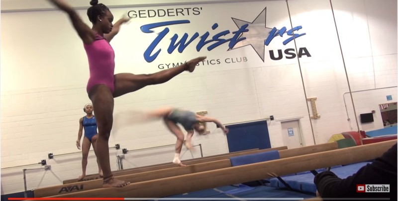 Screenshot of a YouTube video of Trinidadian gymnast, Thema Williams, practising at her coach John Geddert's gym in the United States.
