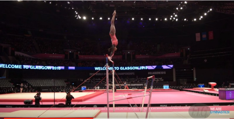 Screengrab of a YouTube video of Trinidad & Tobago gymnast, Thema Williams, competing on the Uneven Bars at the 2015 qualifiers in Scotland.