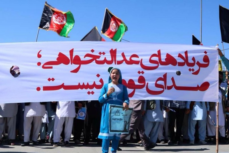 A Hazara girl standing in front of a march in a TUTAP demonstration. Shared via Republic of Silence Facebook page.