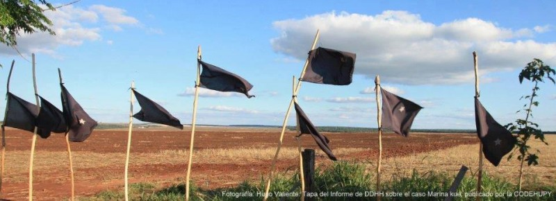 Black flags mark three years and seven months since the massacre, in January, and protest Marinakue is not given back to the State yet