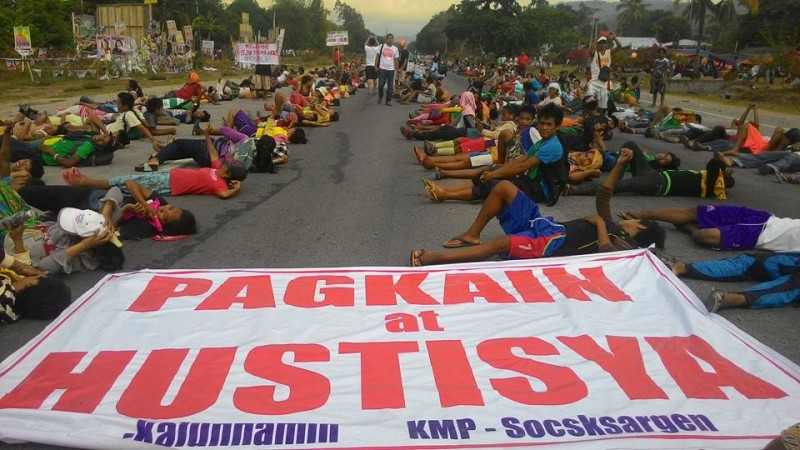 Farmers block a national highway in Koronadal City. The big banner reads: Food and Justice. Photo by Kath Cortez. Source: Facebook