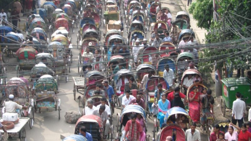 Dhaka's roads are packed with rickshaws in all hues contributing to its traffic woes. Image by Kazi Minhazur Rahman used under Creative Commons license (CC BY-NC 2.0).