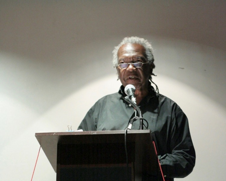 Barbadian-Canadian author Austin Clarke reading at a National Library and Information System Authority (NALIS) event in Trinidad. Photo by Andrew Currie, used under a CC BY 2.0 license.
