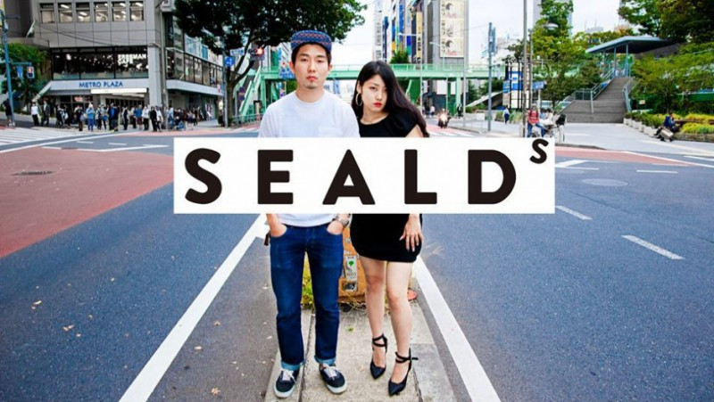 An eye-catching poster from the student group SEALDs, featuring founding member, Wakako Fukuda (right). SEALDs (Students Emergency Action for Liberal Democracy) has changed the image of protesters in Japan, and made it okay to speak out. Credit: Courtesy of SEALDs