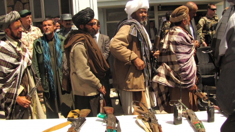 Former Taliban fighters lay down their arms. Wikipedia image.