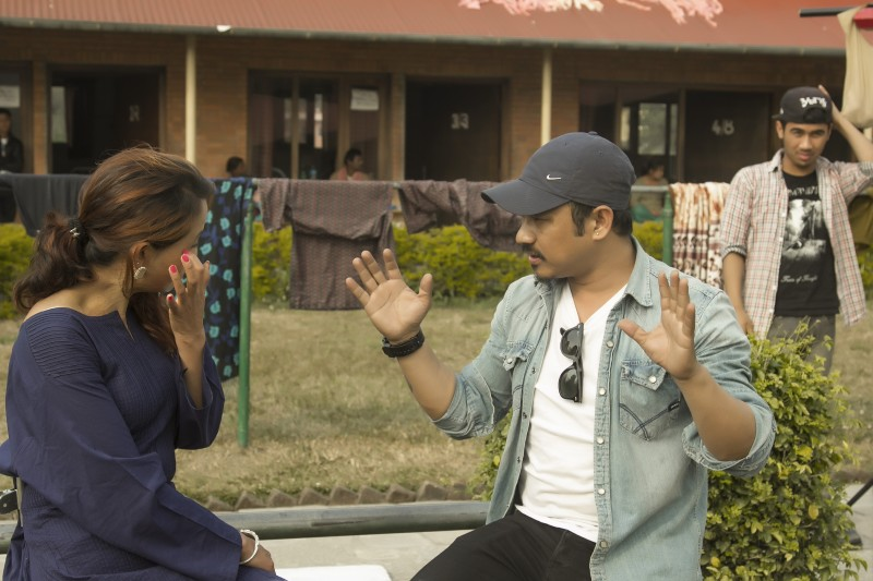 Arjun Shah interacting with a burn survivor prior to the shoot. Used with permission.