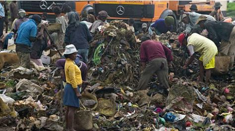 Malagasy citizens going through trash pile ups in Antananarivo via koolsaina