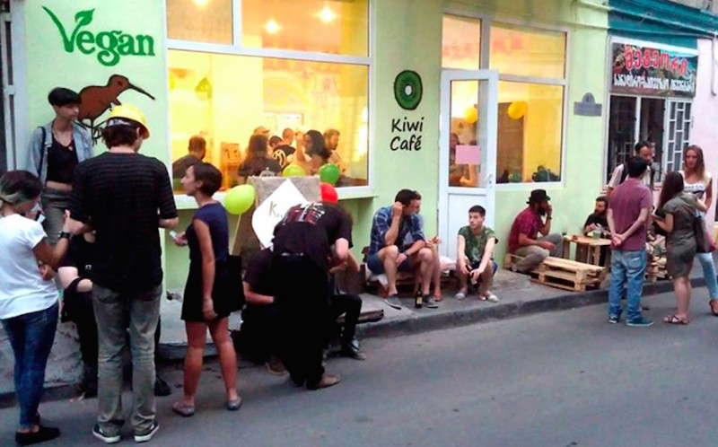 "A movie screening on May 29 at Tbilisi's vegetarian restaurant Kiwi Café, seen here on opening night on July 4, 2015, was disrupted by sausage-wielding assailants, who threw chunks of grilled meat into diners' dishes and came to blows with staff. The café claims the more than one dozen assailants created ""an anti-vegan provocative action."" (Photo: Kiwi Café)"
