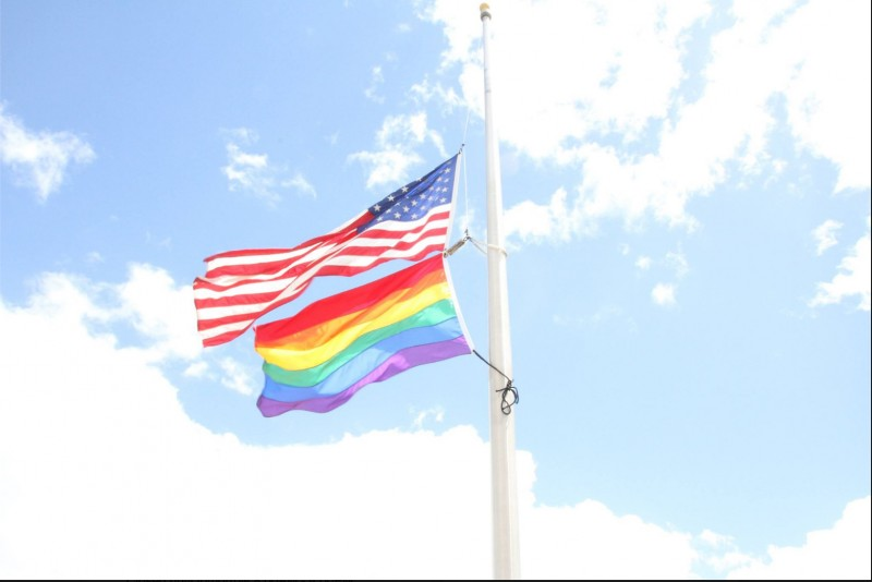 A screenshot of the image posted by the United States Embassy in Jamaica on its Facebook page, showing the US flag and the rainbow flag -- a global symbol of the LGBT movement -- being flown at half mast out of respect for the Orlando nightclub shooting victims.