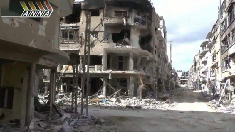 A television screenshot Hassan took of his home street in Syria. Hassan lived in a suburb of Damascus called Darayya, the site of intense fighting between the Syrian regime and rebel forces. (Hassan Jamous)