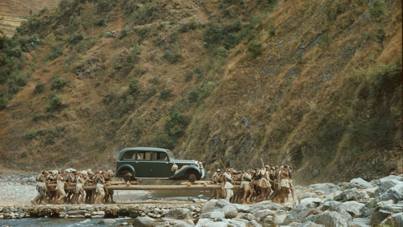 People carrying the first car to the Kathmandu Valley in 1948. Image via Twitter /NepalInPix