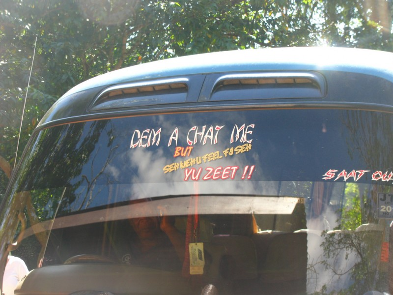 Some Patois phrases being proudly displayed on a bus in Jamaica. Photo by Jason Gullifer, used under a CC BY-NC 2.0 license.