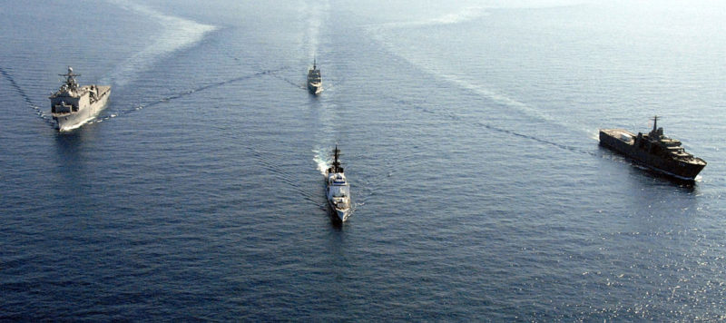 U.S. Navy and Republic of Singapore ships steam through the South China Sea for the second of two combined Republic of Singapore and United States naval formations during a division tactics exercise during Cooperation Afloat Readiness and Training (CARAT) 2008. PHOTO: Public Domain via Wikimedia Commons.