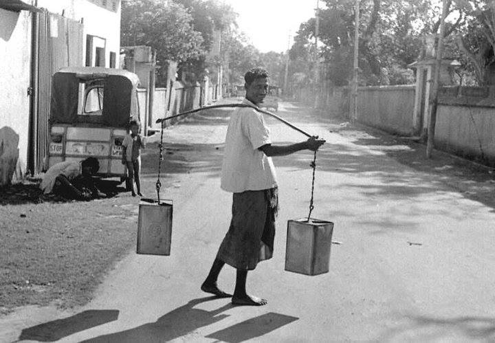 Water carrier, Wari, Dhaka (1965). Photographer- Roger Gwynn. Photo courtesy- Bangladesh Old Photo Archive.