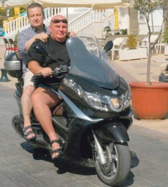 "Serbian politicians Ivica Dačić and Dragan Marković Palma enjoying the summer. Photo by anonymous author first posted on the Facebook page ""Neguj mo srpski jezik"" (""Nurture Serbian Language"")."