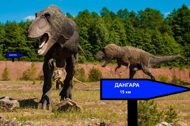 One of the humorous reactions to scholars claiming that a town in Tajikistan is 4,000 years old. The image depicts dinosaurs roaming the earth with two road signs pointing the way to Danghara. Posted on Asia-Plus Media Group's Facebook page, July 16, 2016.