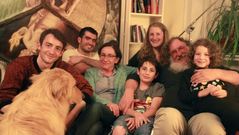 The Jellinek family in their home in Berlin, with their houseguest, Kinan, a Syrian Muslim refugee (second from left). When Chaim Jellinek told Kinan he was Jewish, Kinan said he had no problem with that. Credit: Daniel Estrin. Used with permission