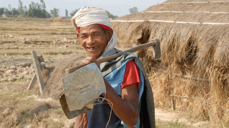 A Tharu man from Nepal is on his way to do farm work on April 26, 2011. Image from Flickr by © ILO/ Pradip Shakya. CC BY-NC-ND 2.0