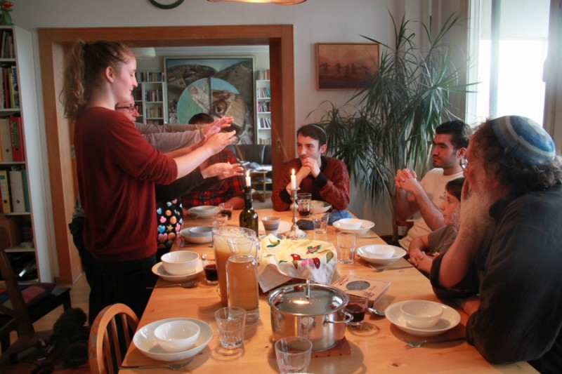 The Jellinek family lights the Sabbath candles for Friday night dinner. Chaim Jellinek says he thinks the only good way to integrate refugees is to welcome them. Credit: Daniel Estrin. Used with permission