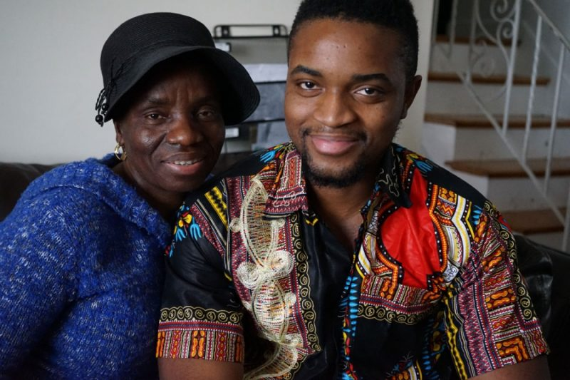 Mercy Krua, and her son Jefferson Krua, on her living room couch in Boston, MA. Credit: Heidi Shin