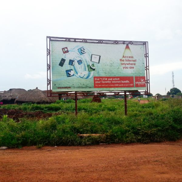 'Access the Internet anywhere you are' says this Vivacell billboard, posted in the small village of Morobo on the border with Uganda in 2015. Only a small minority of South Sudanese have decent Internet access. Photo by Pernille Bærendtsen.