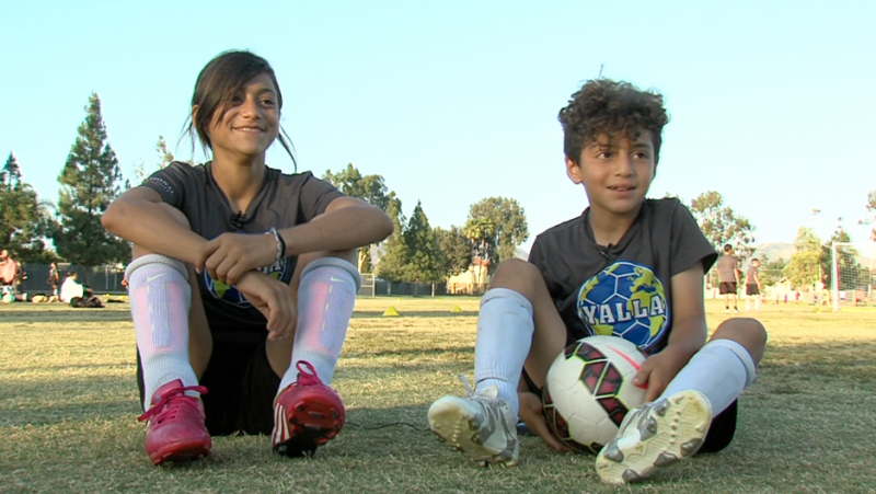 Amira Matti and her brother, both from Guatemala, rest after soccer practice at YALLA, a San Diego-based after-school program that teaches soccer to refugees and immigrants and provides academic mentoring. Credit: Jean Guerrero