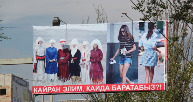 Photo of banner in central Bishkek contrasting traditional and secular dress. Widely shared.
