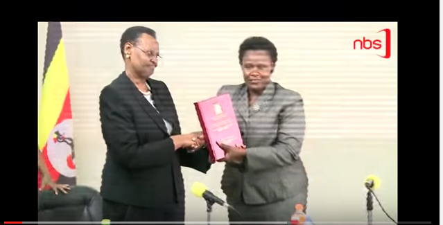 A screenshot of a YouTube video showing Janet Museveni (left) taking over the mantle of Ministry of Education and Sports.